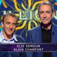 Elie Semoun et Alain Chamfort dans Qui veut gagner des millions ? sur TF1, le vendredi 23 mai 2014.
