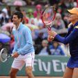 Novak Djokovic et Kristina Mladenovic lors de la journées des Enfants de Roland-Garros, à Roland-Garros, le 24 mai 2014 à Paris