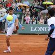 Novak Djokovic et Gaël Monfils lors de la journées des Enfants de Roland-Garros, à Roland-Garros, le 24 mai 2014 à Paris