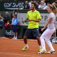 Alizé Cornet et Laurent Lokoli lors de la journées des Enfants de Roland-Garros, à Roland-Garros, le 24 mai 2014 à Paris