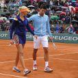 Novak Djokovic et Alizé Cornet lors de la journées des Enfants de Roland-Garros, à Roland-Garros, le 24 mai 2014 à Paris