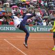 Gaël Monfils et et Laurent Lokoli lors de la journées des Enfants de Roland-Garros, à Roland-Garros, le 24 mai 2014 à Paris