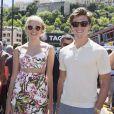 Pixie Lott et son compagnon Oliver Cheshire dans le paddock du Grand Prix de Monaco, le 25 mai 2014