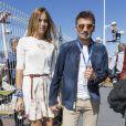 Eleonora Pedron et son compagnon Max Biaggi dans le paddock du Grand Prix de Monaco, le 25 mai 2014