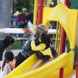 Laeticia Hallyday a passé un moment avec ses filles Jade et Joy dans un parc à Malibu. Les filles étaient très en joie....à chaque passage sur le toboggan, elles embrassaient leur mère. Le 25 mai 2014.