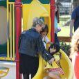 Laeticia Hallyday est allée passer un moment avec ses filles Jade et Joy dans un parc à Malibu. Les filles étaient très en joie....à chaque passage sur le toboggan, elles embrassaient leur mère. Le 25 mai 2014.