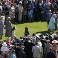Kate Middleton et la reine Elizabeth II en pleine garden party organisée à Buckingham Palace le 10 juin 2014
