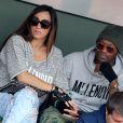 Djibril Cissé et une amie lors des Internationaux de France à Roland-Garros à Paris, le 29 mai 2014