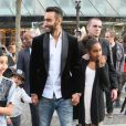 """Exclusif - La Fouine (Laouni Mouhid), entouré de sa fille Fatima (à droite) et de sa nièce, arrive à l'avant-première de son film """"A toute épreuve"""" lors du 3e Champs-Elysées film Festival à Paris, le 13 juin 2014."""