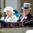 """La reine Elisabeth II, le prince Philip, duc d'Edimbourg au 2e jour de la course hippique """"Royal Ascot"""", le 18 juin 2014."""