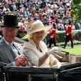 """Le prince Charles et Camilla Parker Bowles, la duchesse de Cornouailles - La famille royale d'Angleterre au 2e jour de la course hippique """"Royal Ascot"""", le 18 juin 2014. La famille a ensuite participé à la """"Eton Tea Party""""."""