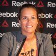 Laure Manaudou en séance de dédicaces chez Intersport à Paris le 23 avril 2014 pour son sponsor Reebok.
