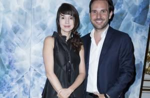 Fashion Week : Christophe Michalak souriant avec Delphine, jeune maman stylée