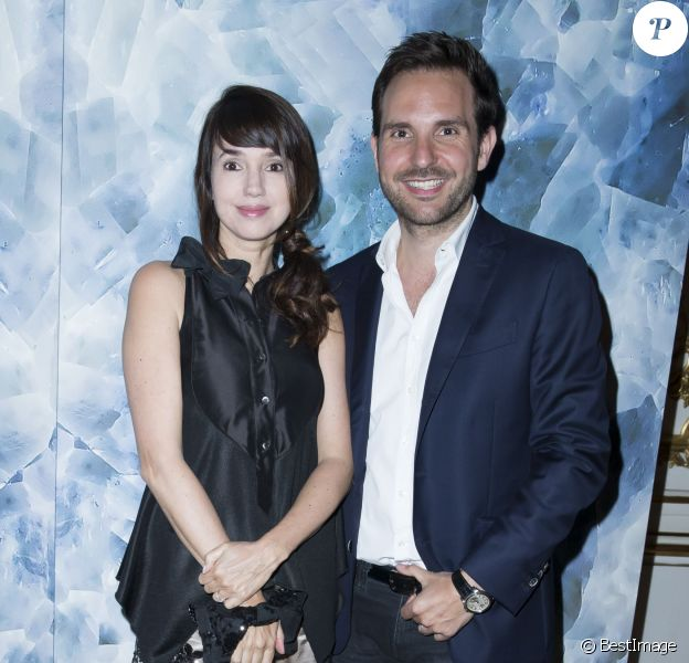 Delphine McCarty et Christophe Michalak assistent au défilé haute couture Alexis Mabille automne-hiver 2014-2015 à l'hôtel d'Évreux. Paris, le 7 juillet 2014.