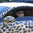 Exclusif - Justin Bieber, dans les rues de Los Angeles dans une Audi R8 au motif panthère. Le 9 juillet 2014.