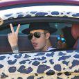 Exclusif - Justin Bieber se promène dans les rues de Los Angeles dans une Audi R8 au motif panthère. Le 9 juillet 2014.