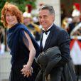 Gérard Holtz et son épouse Muriel Mayette au palais de l'Elysée, lors d'un dîner en l'honneur de la reine Elizabteh II, à Paris le 6 juin 2014