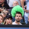 Shakira, enceinte, et son compagnon Gerard Piqué assistent au quart de finale de la coupe du monde de basket entre la Slovénie et les USA à Barcelone en Espagne le 9 septembre 2014.