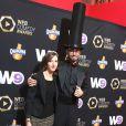 """Cyprien et sa compagne Aurélie lors de la cérémonie du Web """"Les Web Comedy Awards"""" à Bobino. Le 21 mars 2014."""
