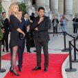 Adriana Karembeu et son mari André Ohanian participent au Gala des 150 ans de la Croix-Rouge française au Grand Palais, à Paris, le 12 septembre 2014.