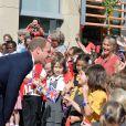 Le prince William en visite à Oxford seul, sans son épouse la duchesse Catherine, souffrante, le 8 septembre 2014, jour de l'annonce de sa seconde grossesse.