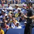 Andy Murray lors de son premier tour de l'US Open sous les yeux d'Amélie Mauresmo, à Flushing Meadows à New York le 25 août 2014