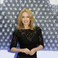 """Kylie Minogue assiste au lancement de la nouvelle bouteille d'eau """"Glaceau Smartwater"""" au Dairy Art Centre à Londres, le 28 août 2014."""