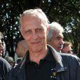 """Tom Novembre lors du 2e tournoi de pétanque au profit de l'association """"MeghanOra"""" sur l'Esplanade des Invalides à Paris, le 28 septembre 2014"""