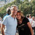 """Laurent Petitguillaume et Martine Boukobza, présidente de l'association """"MeghanOra""""  lors du 2e tournoi de pétanque de l'association sur l'Esplanade des Invalides à Paris, le 28 septembre 2014"""
