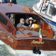 George Clooney et sa femme Amal Alamuddin quittent Venise, le 29 septembre 2014 après leur mariage.