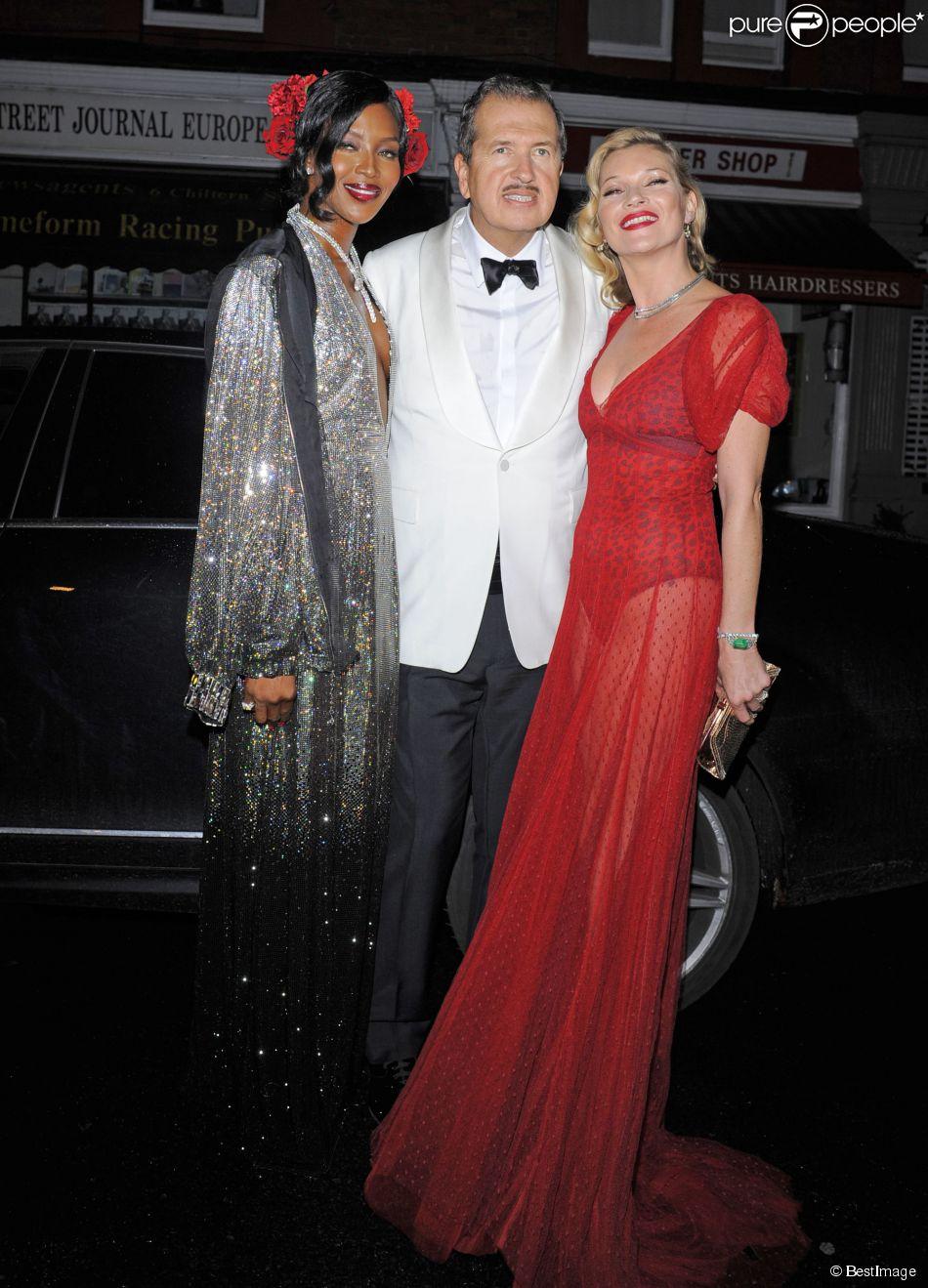 Naomi Campbell et Kate Moss fêtent les 60 ans de leur ami Mario Testino à la Chiltern Firehouse. Londres, le 29 octobre 2014.