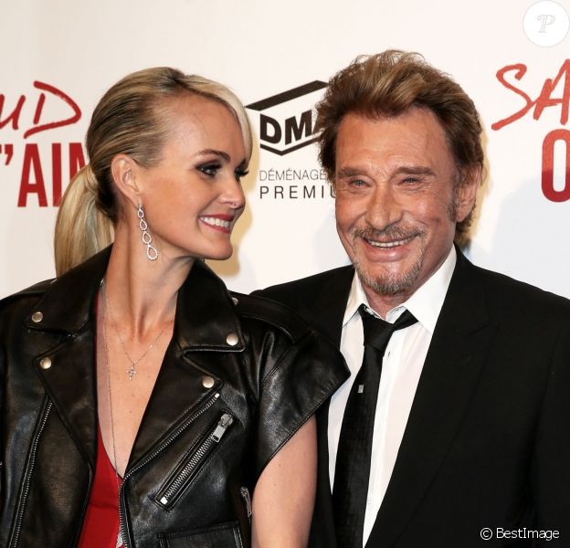 Johnny Hallyday et sa femme Laeticia, amoureux à l'avant-première du film Salaud on t'aime à l'UGC Normandie sur les Champs-Elysées à Paris le 31 mars 2014.