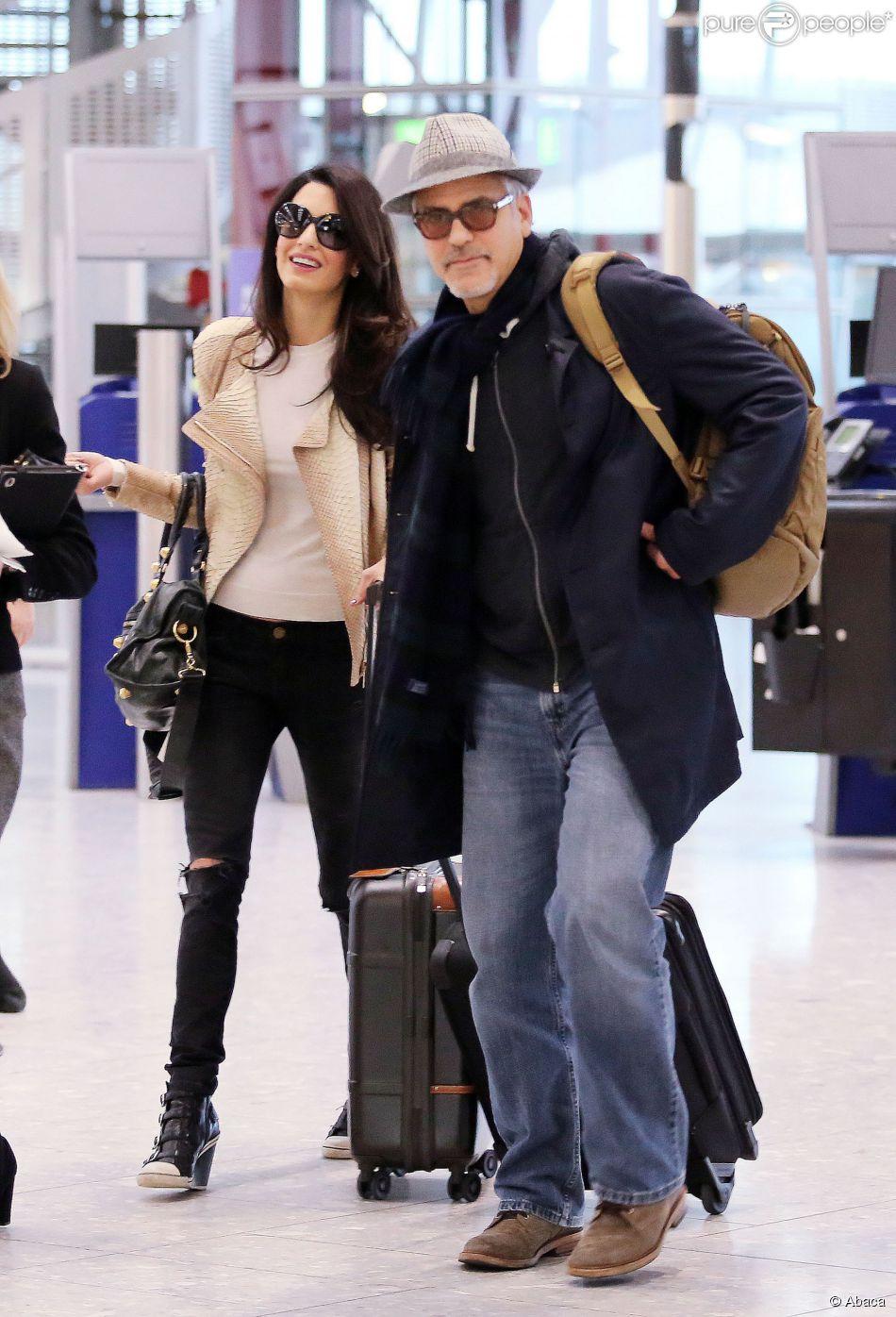 George et Amal Clooney à l'aéroport d'Heathrow à Londres en direction des Etats-Unis le 27 novembre 2014
