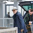 George Clooney avec sa femme Amal à l'aéroport d'Heathrow à Londres en direction des Etats-Unis le 27 novembre 2014