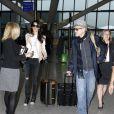 George Clooney et sa femme Amal Alamuddin quittant l'aéroport de Londres le 27 novembre 2014.