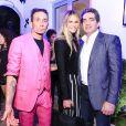 Richard Stark (co-fondateur de Chrome Hearts), Elle MacPherson et son compagnon Jeffrey Soffer assistent à la soirée d'inauguration du nouveau magasin Chrome Hearts, situé dans le Design District. Miami, le 3 décembre 2014.