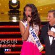 Jean-Pierre Foucault et Flora Coquerel (Miss France 2014) lors de la cérémonie de Miss France 2015 sur TF1, le samedi 6 décembre 2014.