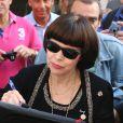 """Exclusif - Mireille Mathieu est allée faire la promotion de son album """"Best Of"""" qui célèbrera ses 50 ans de carrière dans l'émission """"A la bonne heure"""" sur RTL. En sortant la chanteuse s'est rendue chez Chanel pour faire des essayages. Paris, le 1er octobre 2014"""