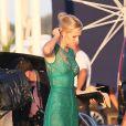 Toni Garrn quitte Saint-Tropez, le 23 juillet 2014, pour assister à la soirée caritative de Leonardo DiCaprio.