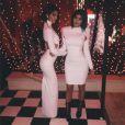 Kendall et Kylie Jenner, divines en robes blanches lors de la soirée de Noël de la famille Kardashian. Los Angeles, le 24 décembre 2014.
