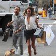 John Legend et Chrissy Teigen et leur chien lors d'une séance photo à New York, le 1er décembre 2014