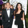 George Clooney (en Giorgio Armani) et sa femme Amal Clooney Alamuddin (en Dior) lors des Golden Globes Awards à Los Angeles le 11 janvier 2015