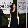Amal Clooney, dans une robe Dior, lors des Golden Globes Awards à Los Angeles le 11 janvier 2015