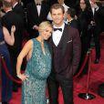 Elsa Pataky enceinte et son mari Chris Hemsworth à la 86ème cérémonie des Oscars à Hollywood, le 2 mars 2014.