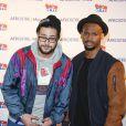 Hakim Jemili et Jérémie Dethelot (Le Woop) assistent au lancement du label AfrostreamVOD chez TF1 à Boulogne-Billancourt, le 4 mars 2015.