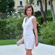 """Milla Jovovich enceinte (montre Jaeger-LeCoultre) - Première du film """"Cymbeline"""" lors du 71e festival international du film de Venise le 3 septembre 2014."""