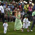 """Tiger Woods, ses enfants Sam et Charlie et sa compagne Lindsey Vonn à l'occasion du """"Par 3 Contest"""" au National Golf Club d'Augusta, le 8 avril 2015"""