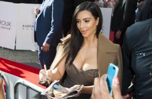 Kim Kardashian : Numéro de charme réussi sur les Champs-Élysées