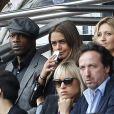 Sylvain Wiltord et une amie assistent au match PSG-Lille lors de la 34ème journée au Parc des Princes à Paris, le 25 avril 2015.