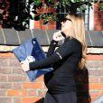 Abbey Clancy, enceinte de son second enfant, prend la direction de la salle de sport à Londres, le 27 avril 2015